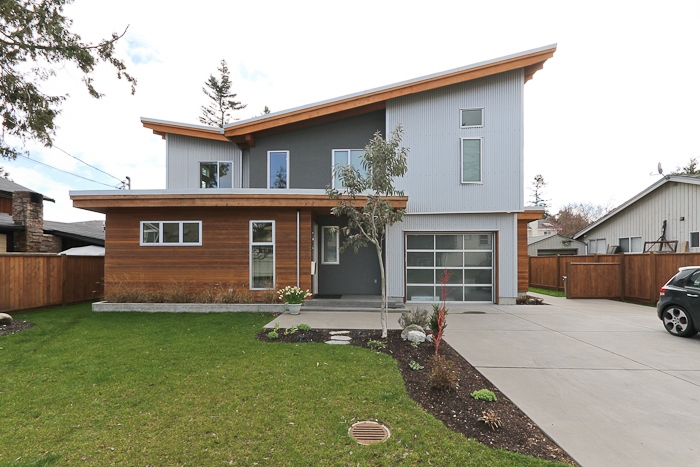 Corrugate metal cladding modern vancouver houses for Modern homes with metal roofs